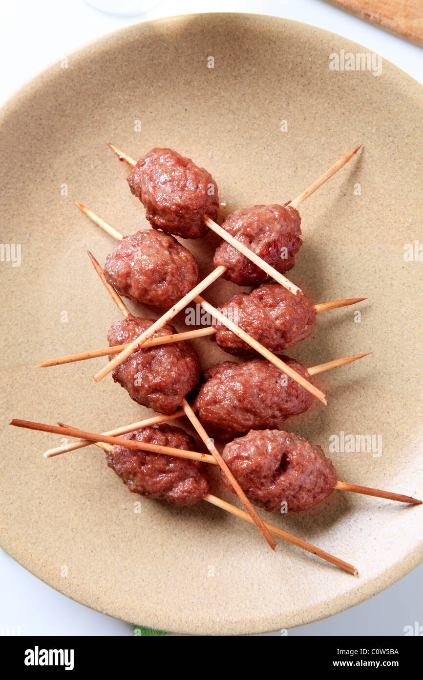 Roast minced meat balls on skewers - closeup - Stock Image