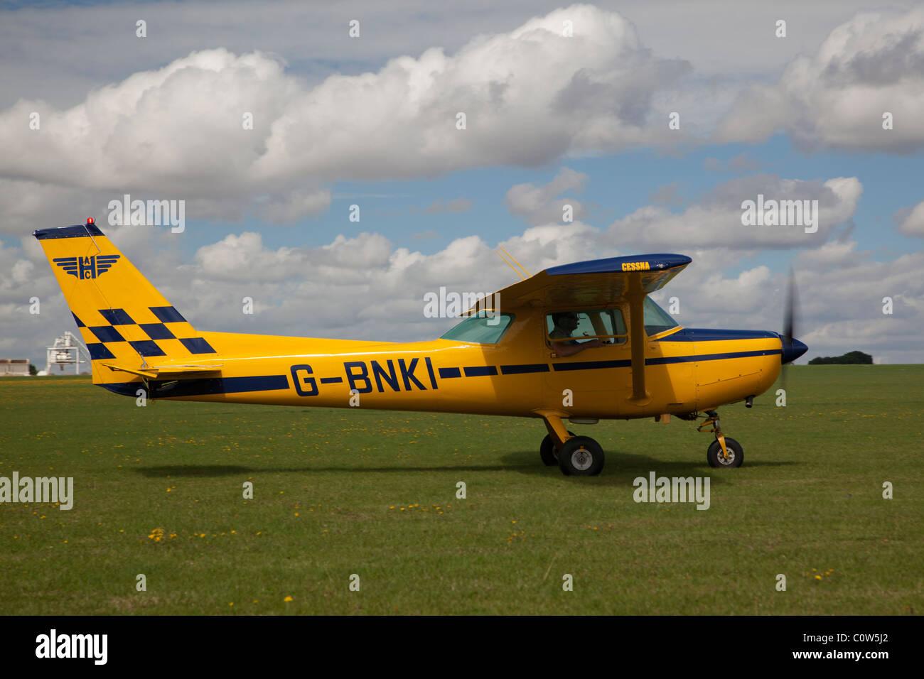 Cessna 152 reg G-BNKI, at Sywell - Stock Image