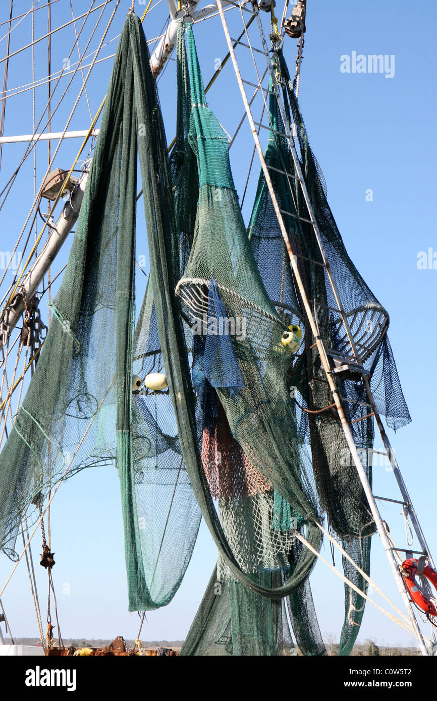 Shrimp nets hanging out to dry in the sun on a shrimper's boat docked at Apalachicola, FL. - Stock Image