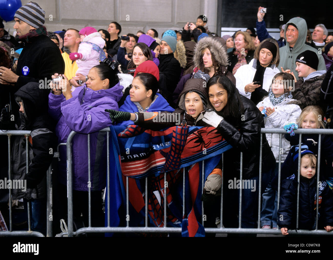Macy's Thanksgiving Day Parade Crowd of People Watching on the Street New York City USA - Stock Image