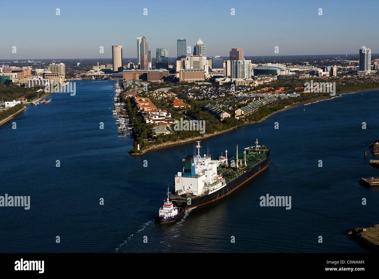 aerial view above tug boat pushing oil tanker Tampa bay Florida - Stock Image