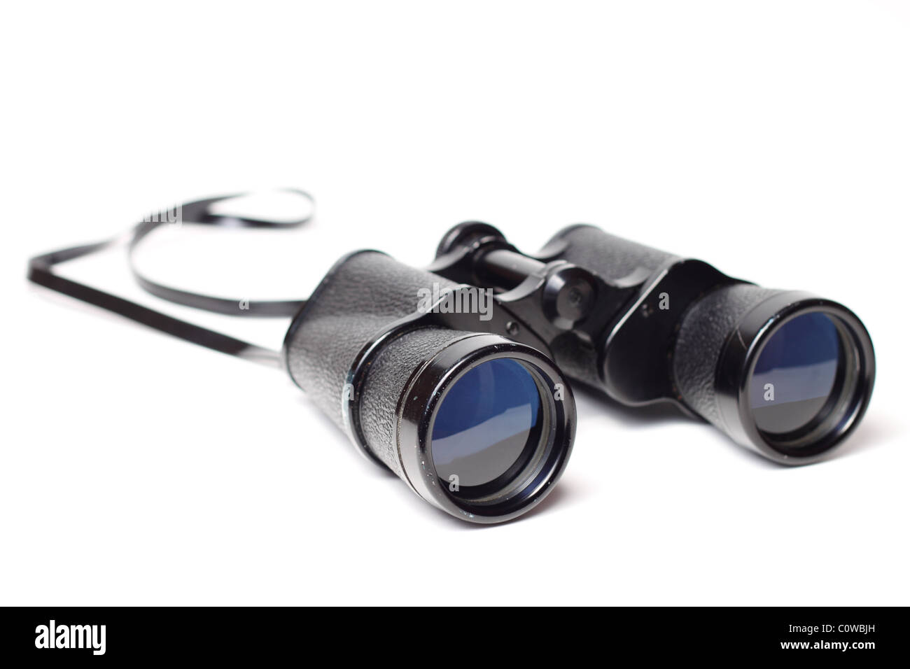 Pair of old binoculars isolated on white background - Stock Image