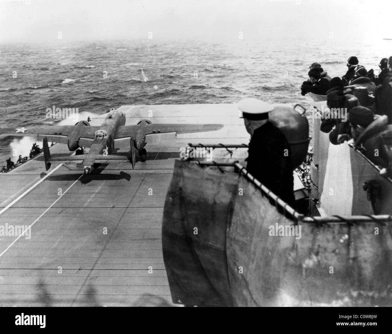 B-25 about to take off from an aircraft carrier somewhere in the Pacific Ocean. - Stock Image