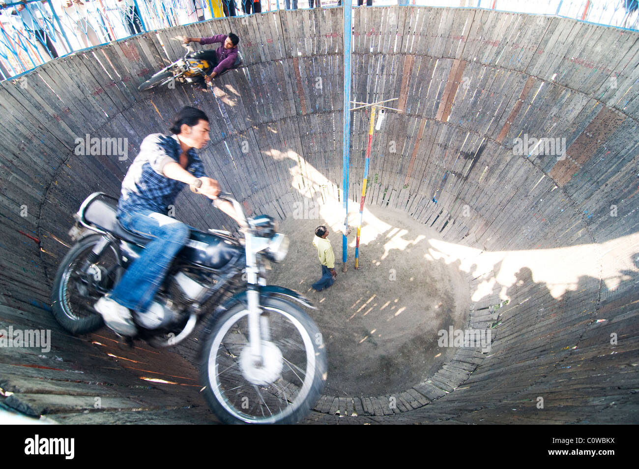 Bikers performing stunts in a rural circus in India. Stock Photo