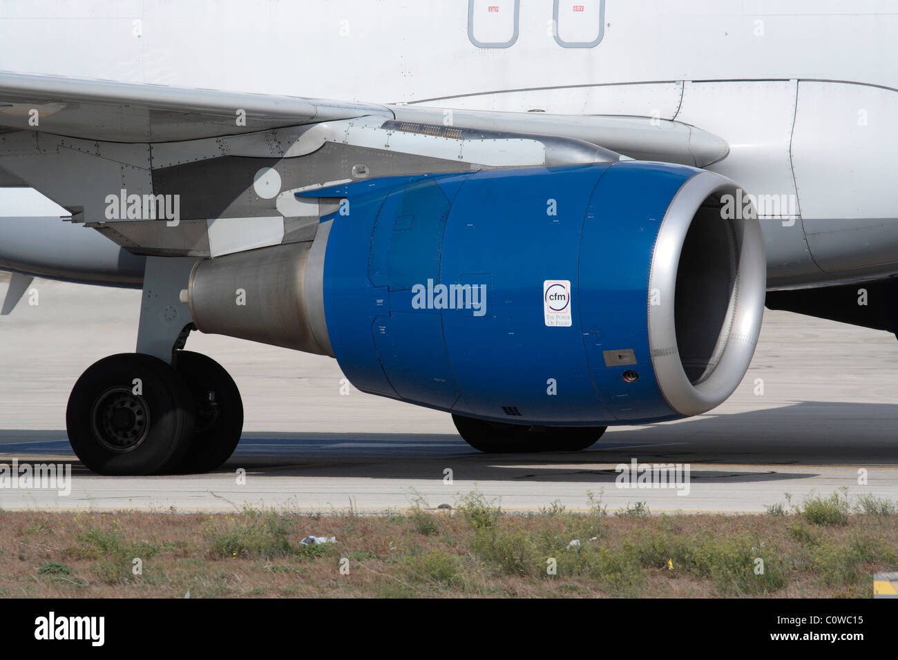 Close-up of a CFM56 turbofan jet engine on an Airbus A320, with CFM logo visible on the engine nacelle. Editorial - Stock Image