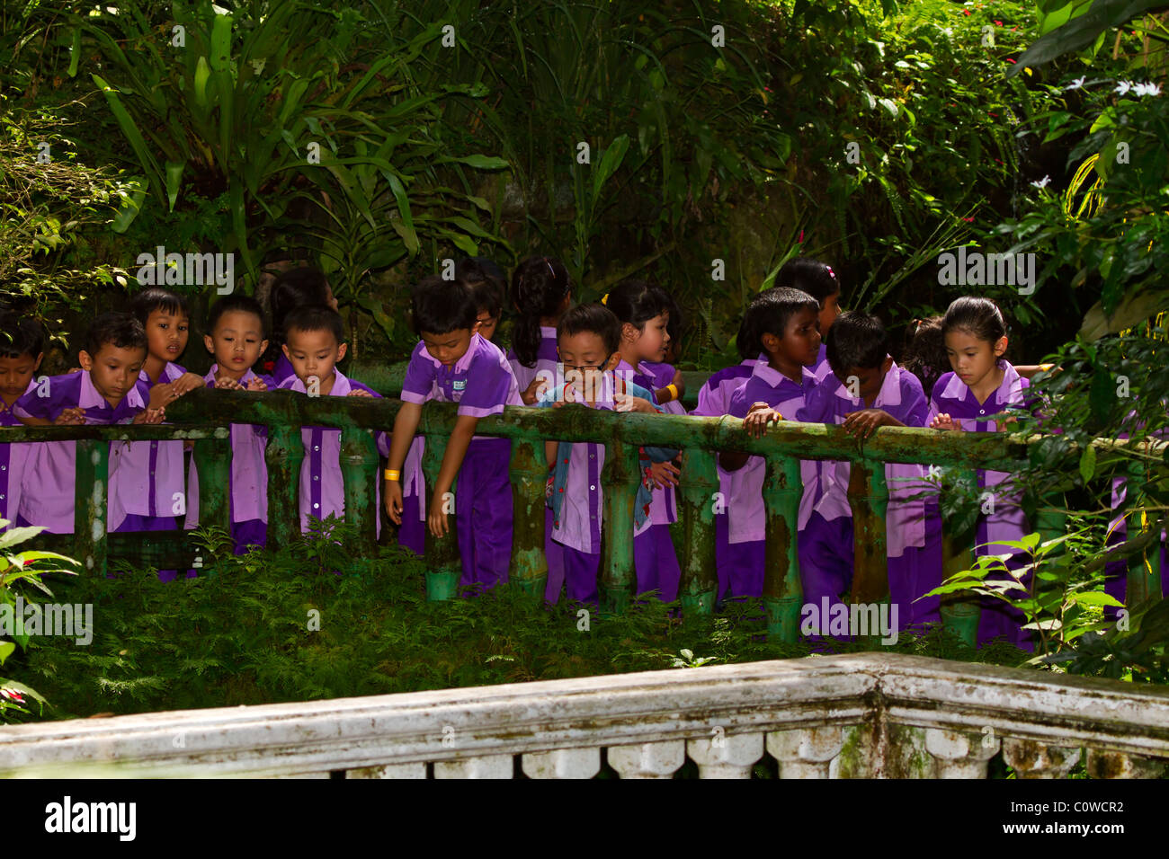 Malaysian schoolchildren in uniforms on an outing in Kuala Lumpur. The children show a wide range of ethnic and - Stock Image