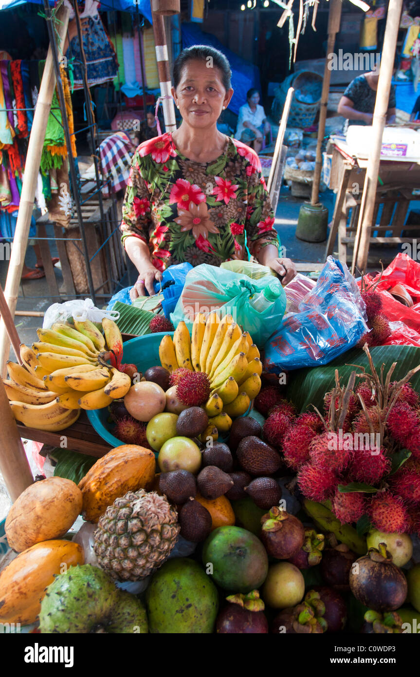 Woman selling tropical fruit in the public market in Ubud Bali Indonesia - Stock Image