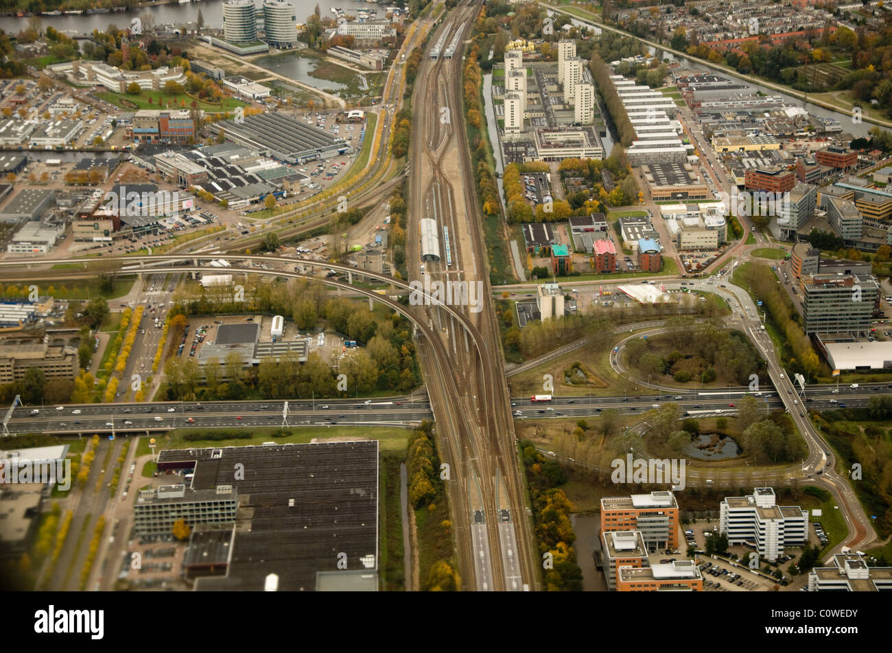 Aerial view from airplane from roads and highways of Amsterdam, Netherlands. - Stock Image