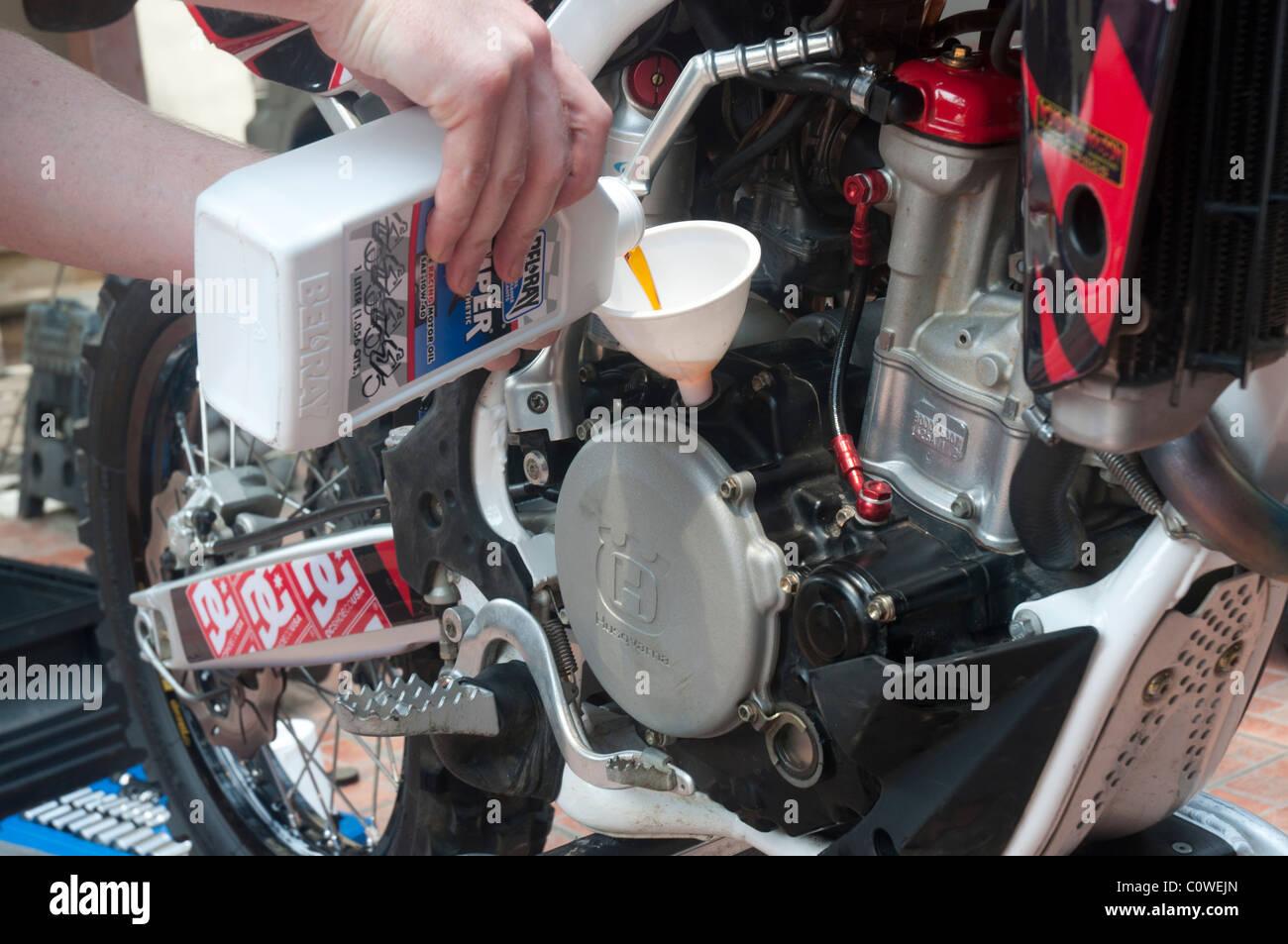 Replacing oil in Husqvarna motor cross bike - Stock Image