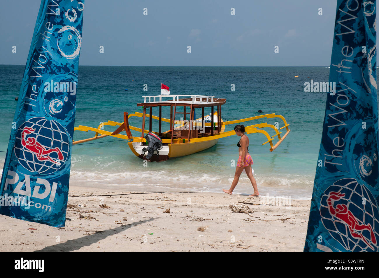 Glass bottomed dive boat on the beach at Gili Trawangan a small island off Lombok, Indonesia Stock Photo