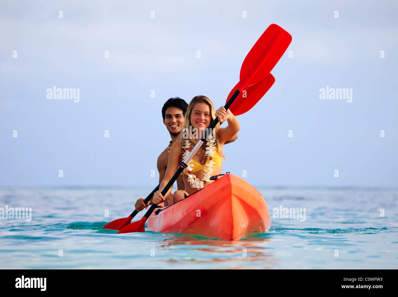 young couple with their kayak in hawaii - Stock Image