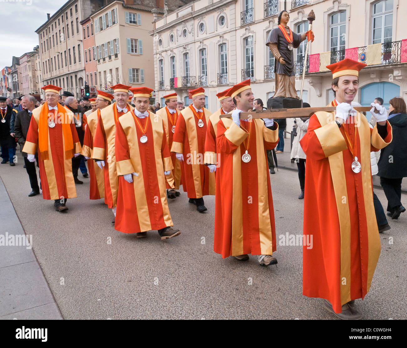 "Procession in traditional garments of the vineyard brotherhoods during the traditional feast of the ""Saint-Vincent Stock Photo"