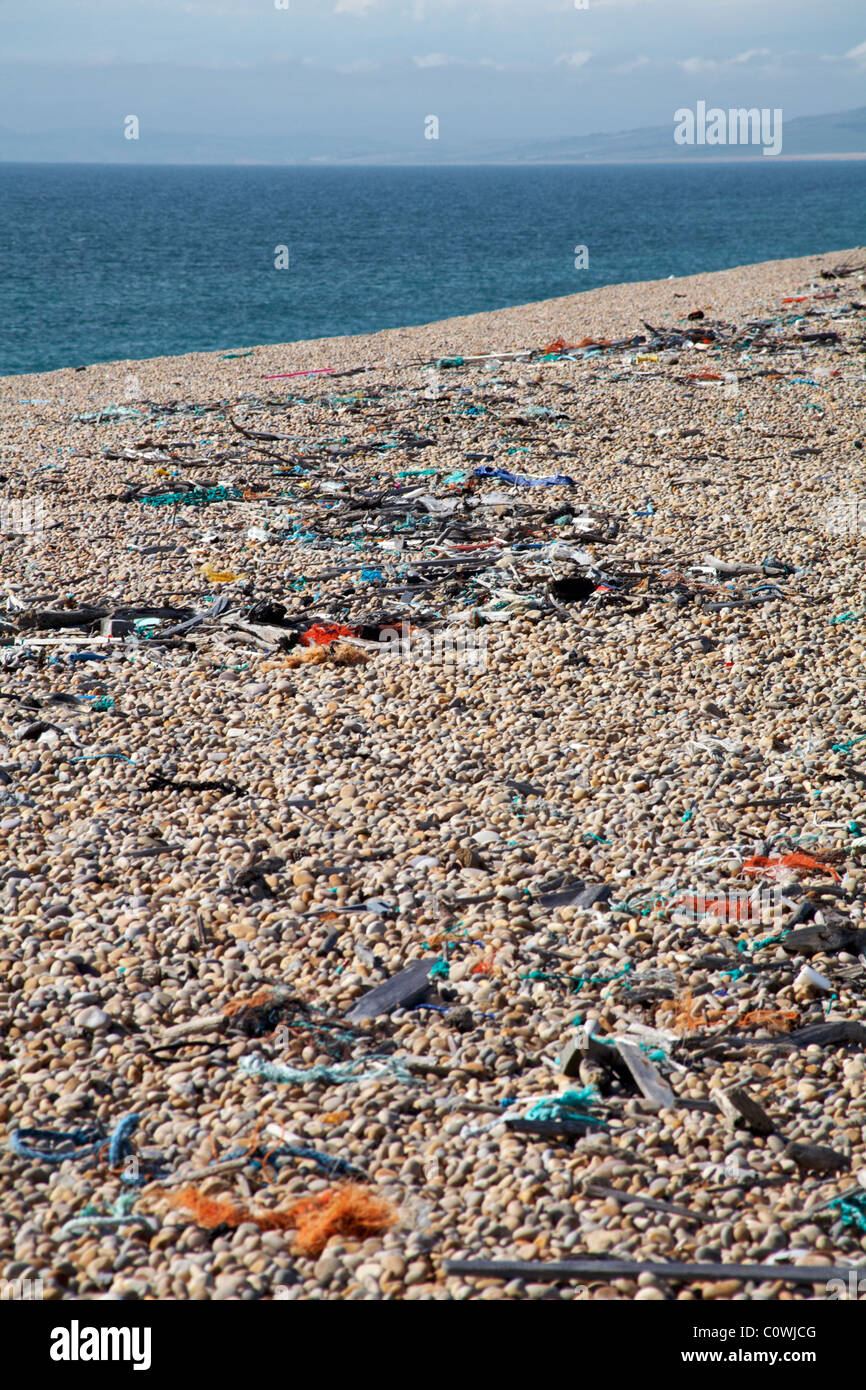 Jetsam and flotsam washed up on the pebbled bank at Chesil in August - Stock Image