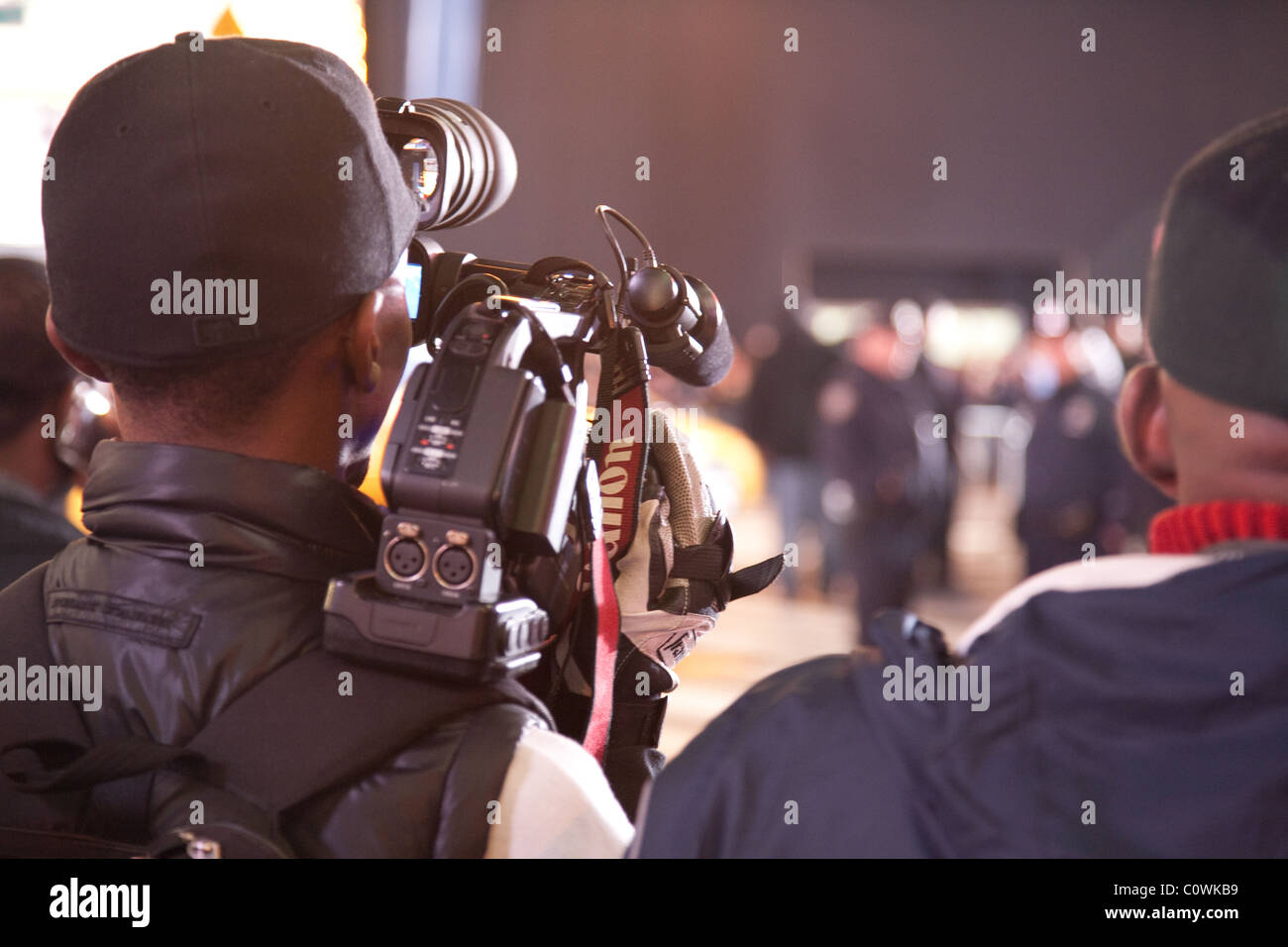 Cameramen with camera film an event - Stock Image
