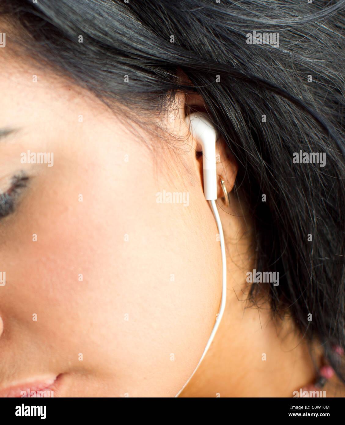 Girl wearing earphones - Stock Image