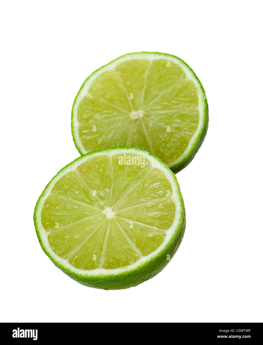 Fresh lime sliced in half isolated against a white background - Stock Image