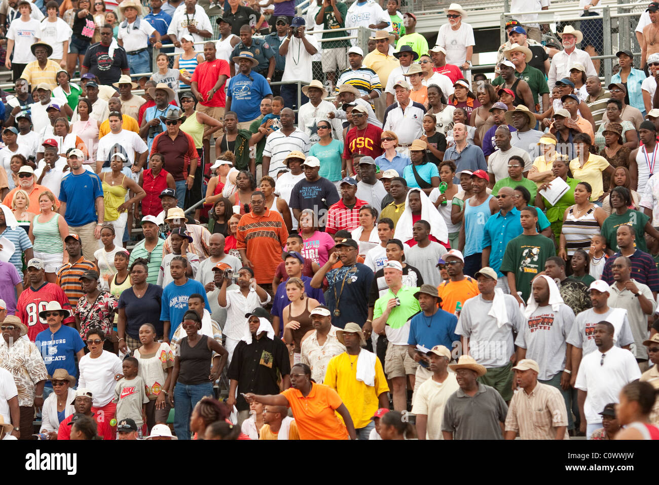 Fans watch finish of race at the Texas state high school track and field championships in Austin. - Stock Image
