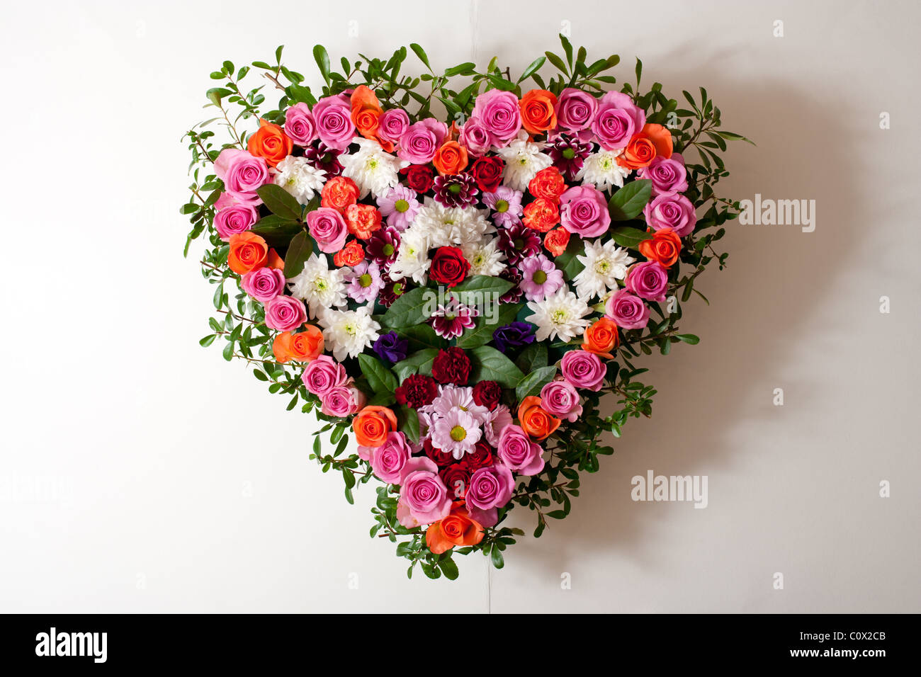 Heart shaped funeral flowers stock photo 34993403 alamy heart shaped funeral flowers izmirmasajfo