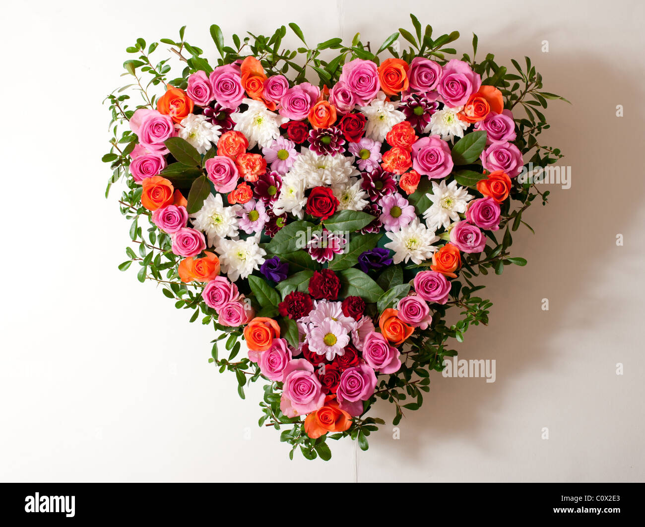 Heart shaped funeral flowers stock photo 34993451 alamy heart shaped funeral flowers izmirmasajfo