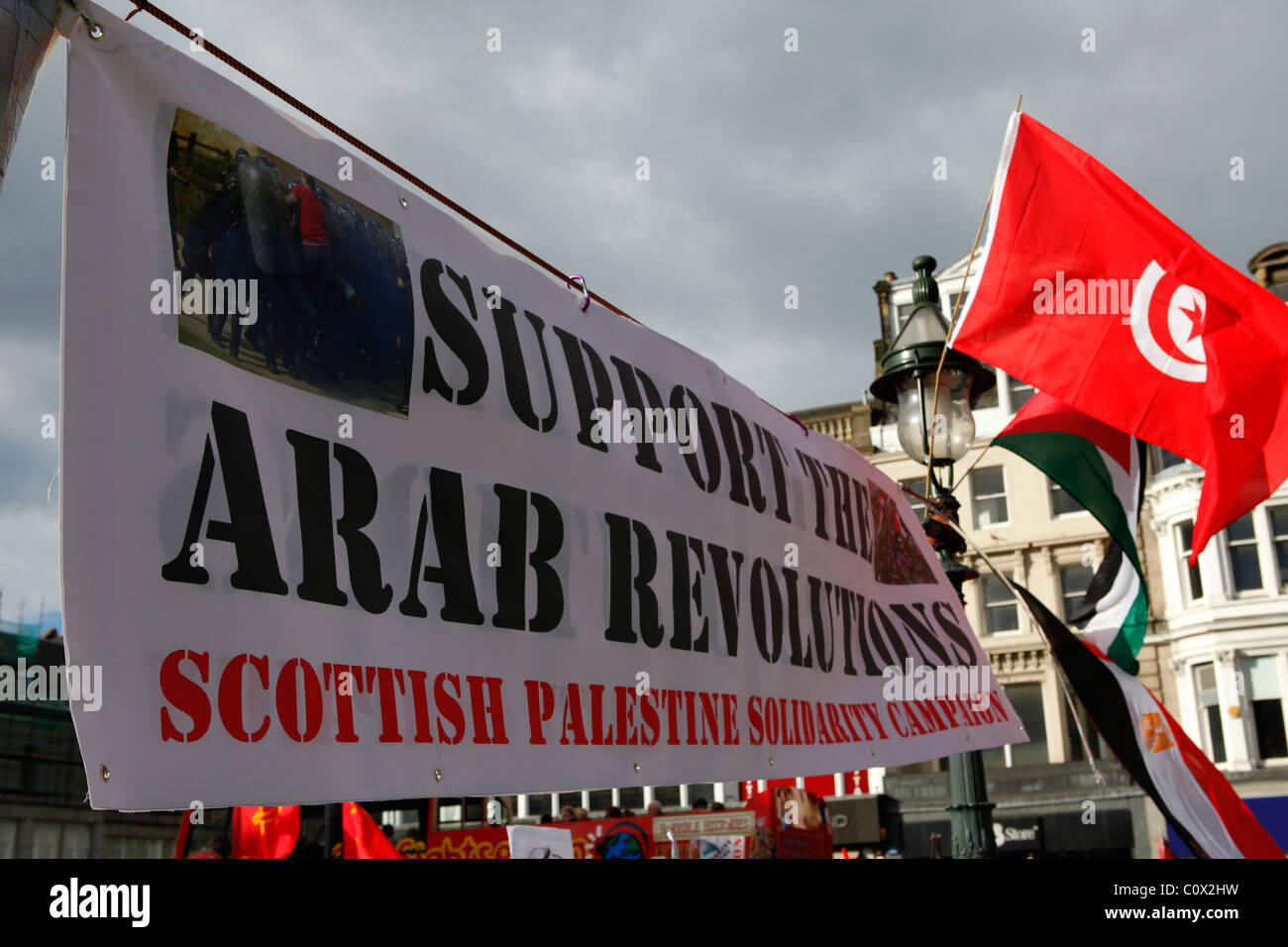 A sign calls for support for the Arab revolutions of 2011 at a demonstration in Edinburgh, Scotland. - Stock Image
