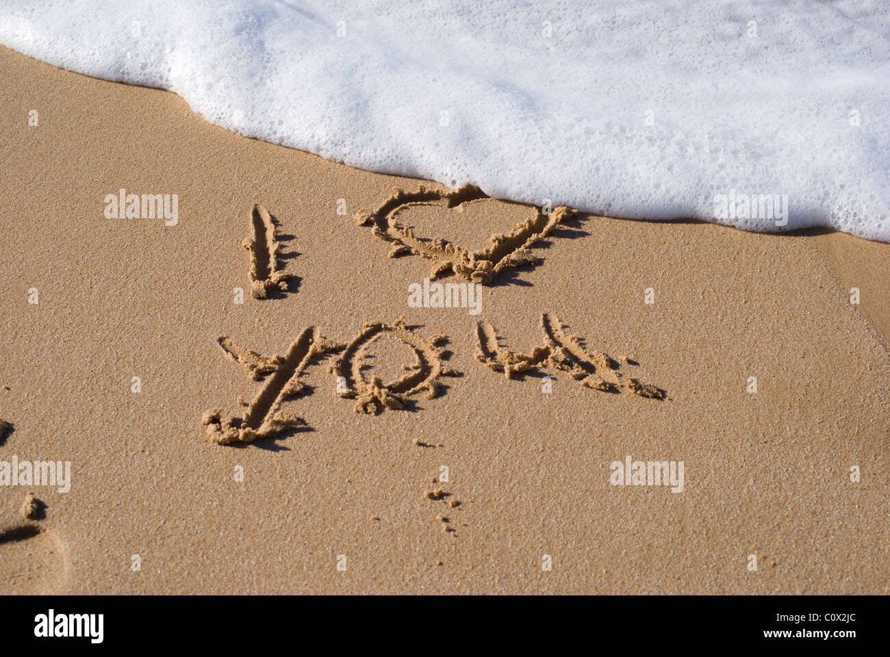 Writing in the sand (I love you) - Stock Image