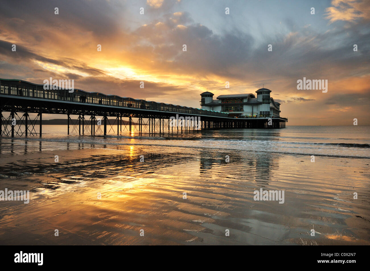 A sunset at the new pier in Weston Super Mare, Somerset. - Stock Image