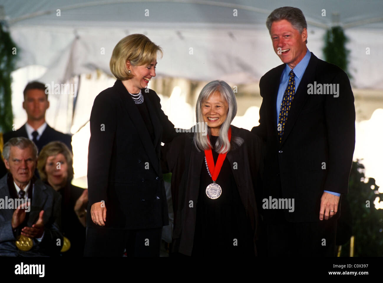 President Bill Clinton and First Lady Hillary Clinton honoring Mazine Hong Kingston at the Arts and Humanity Awards Stock Photo