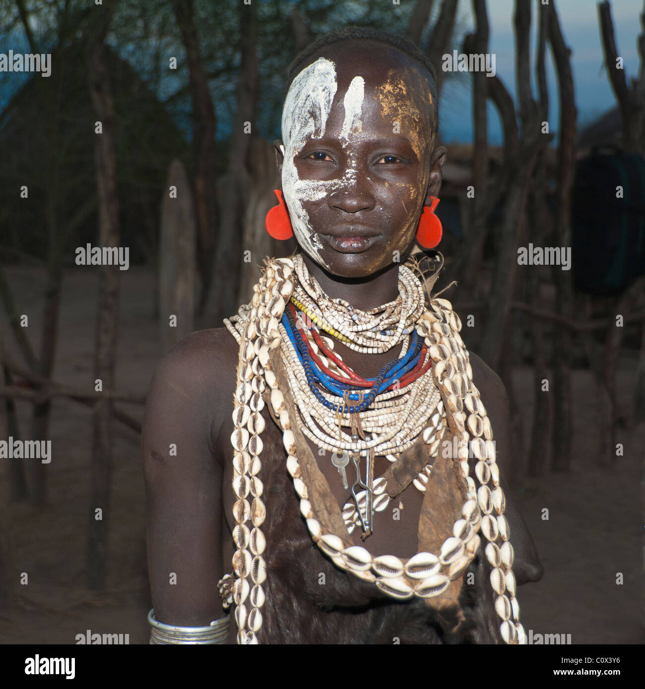 Portrait of a Karo woman with necklaces made of Cowry shells, Omo river valley, Southern Ethiopia Stock Photo