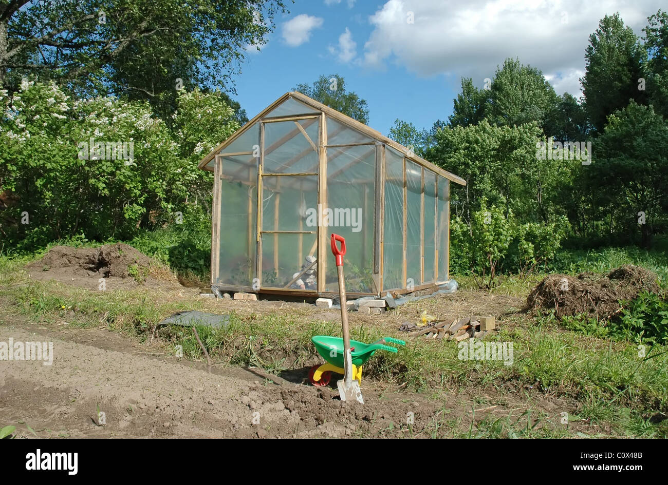 laminated greenhouse in garden - Stock Image