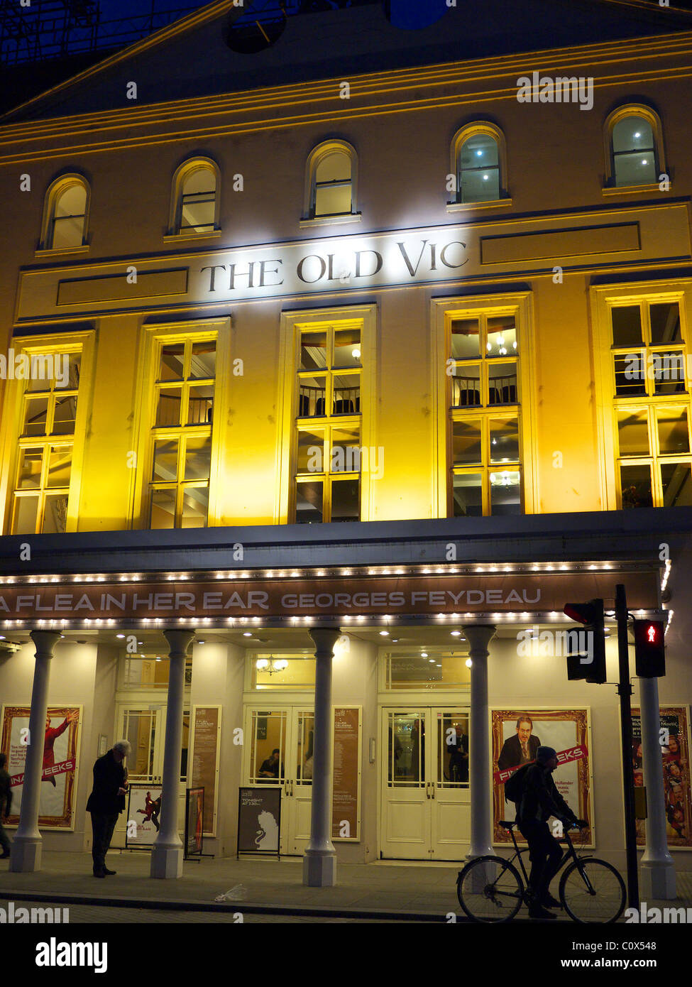 Front view of The Old Vic theatre floodlit at night in London - Stock Image