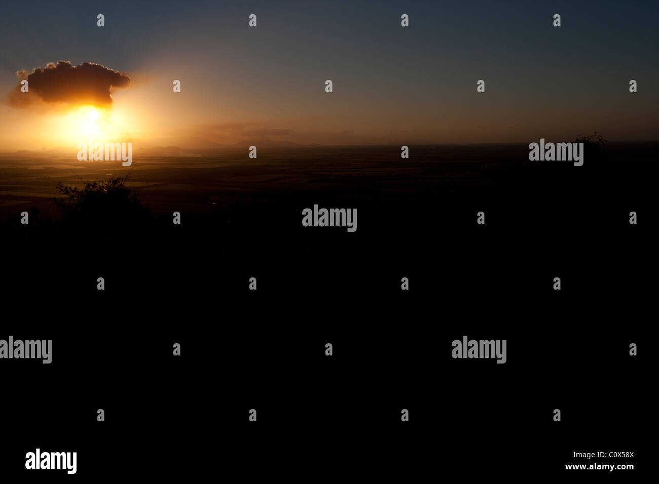 Sun bursting from cloud with rays of light. Symbolic of hope, renewal, energy. - Stock Image
