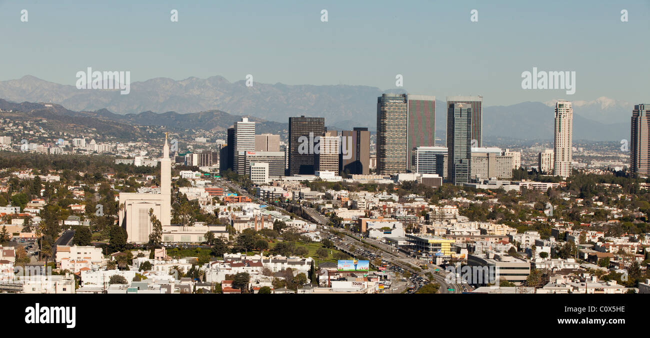 Skyline of Century City/Los Angeles showing office buildings and mountains in background - Stock Image