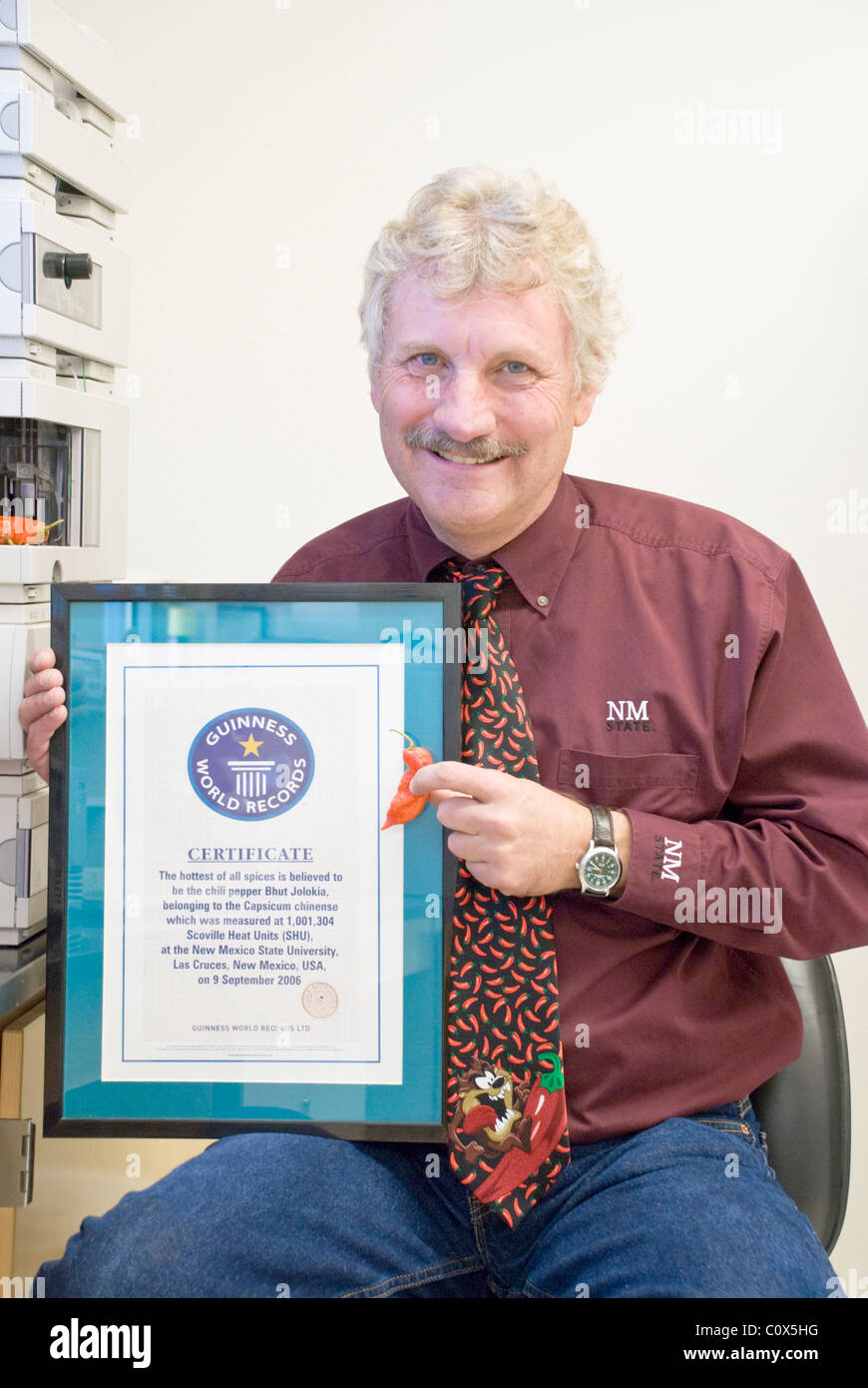 Certified by Guinness World Records, Professor Paul Bosland displays the Bhut Jolokia - once the world's hottest - Stock Image