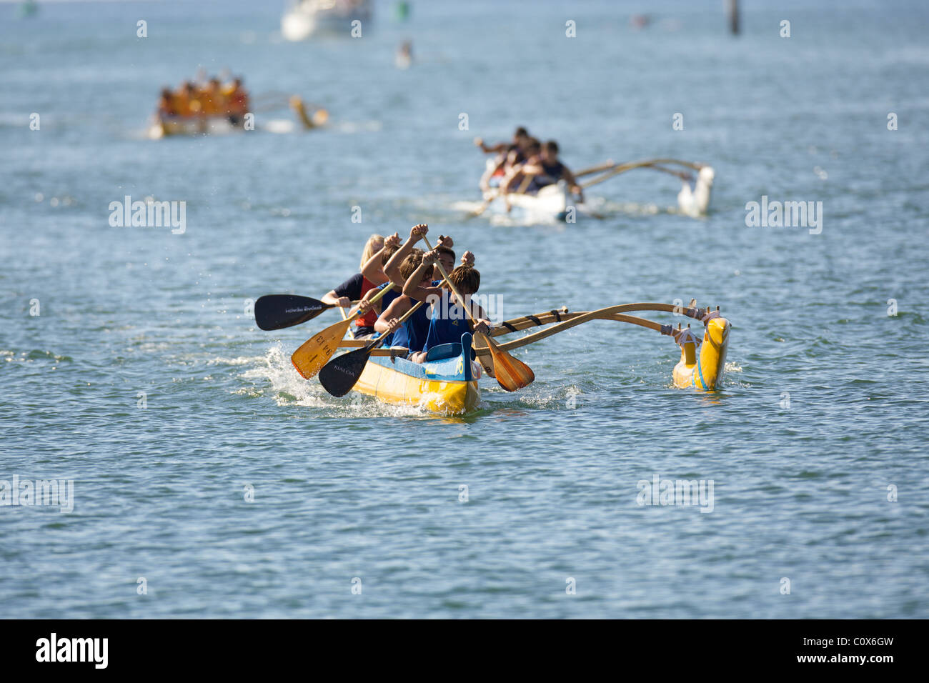 Outrigger canoe paddlers - Stock Image