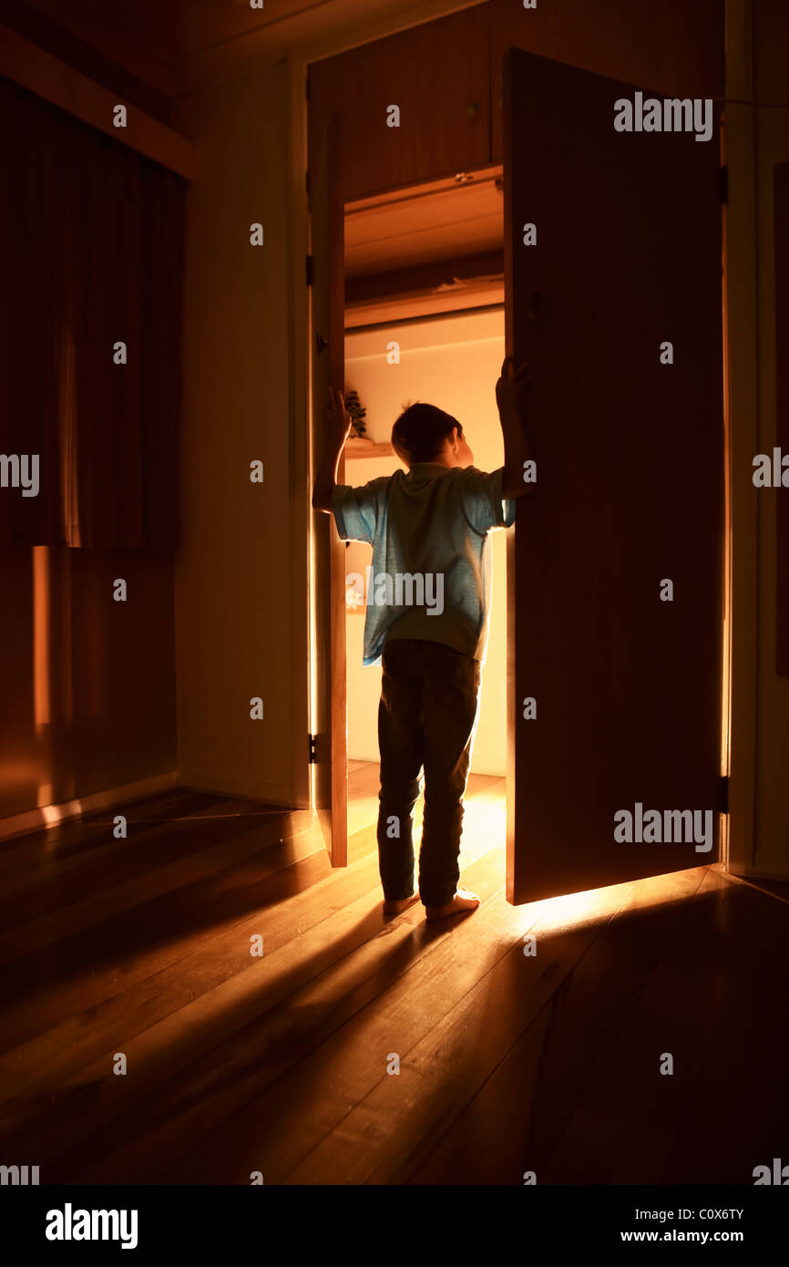 Light shines out from cupboard doors - Stock Image