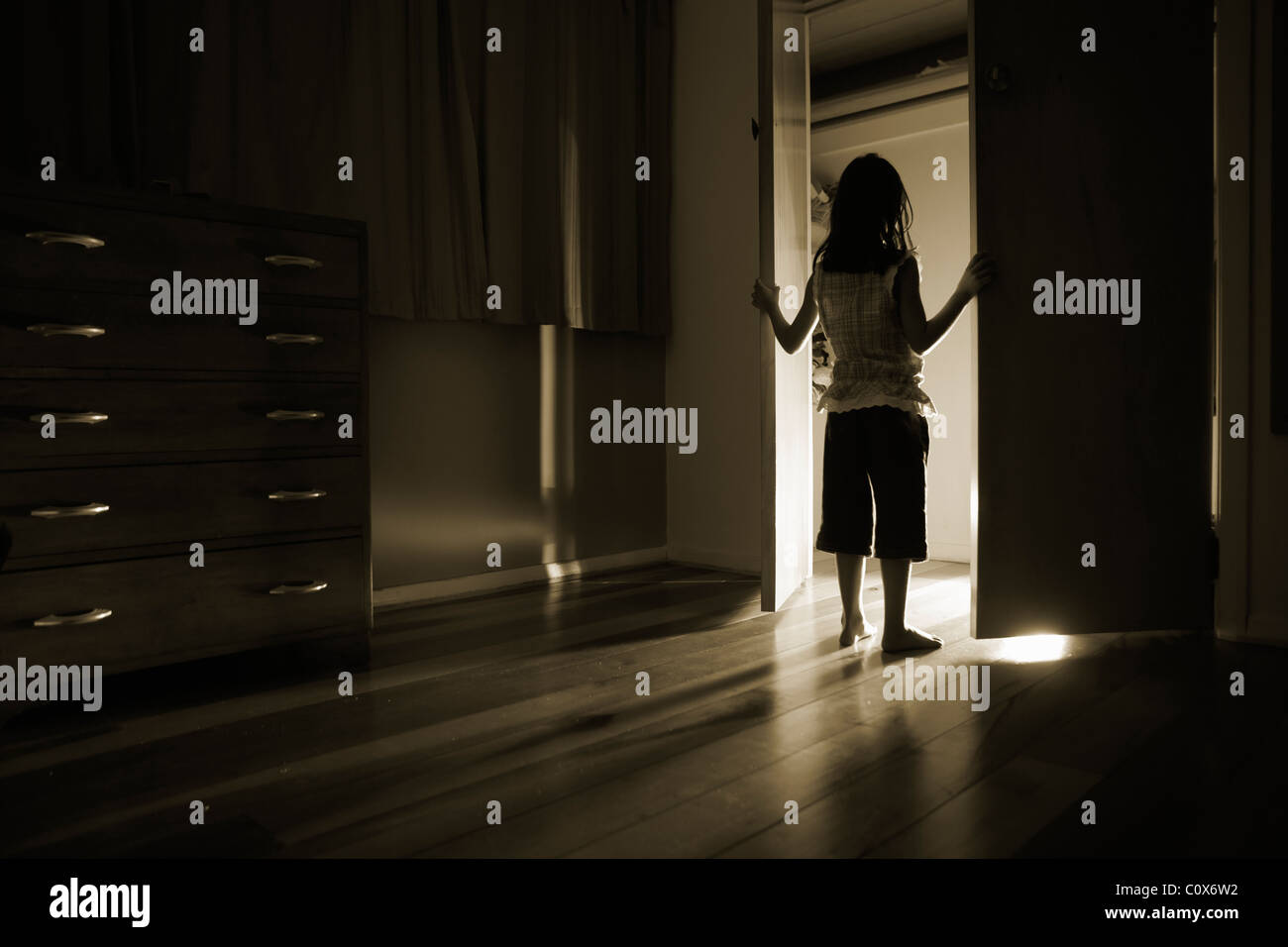 Light shines out from cupboard doors Stock Photo