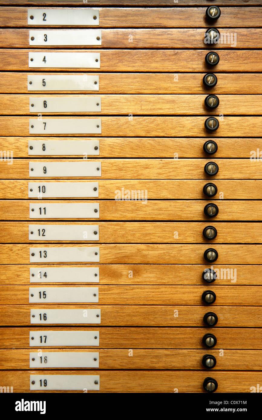 Numbered trays holding microscope slides - Stock Image