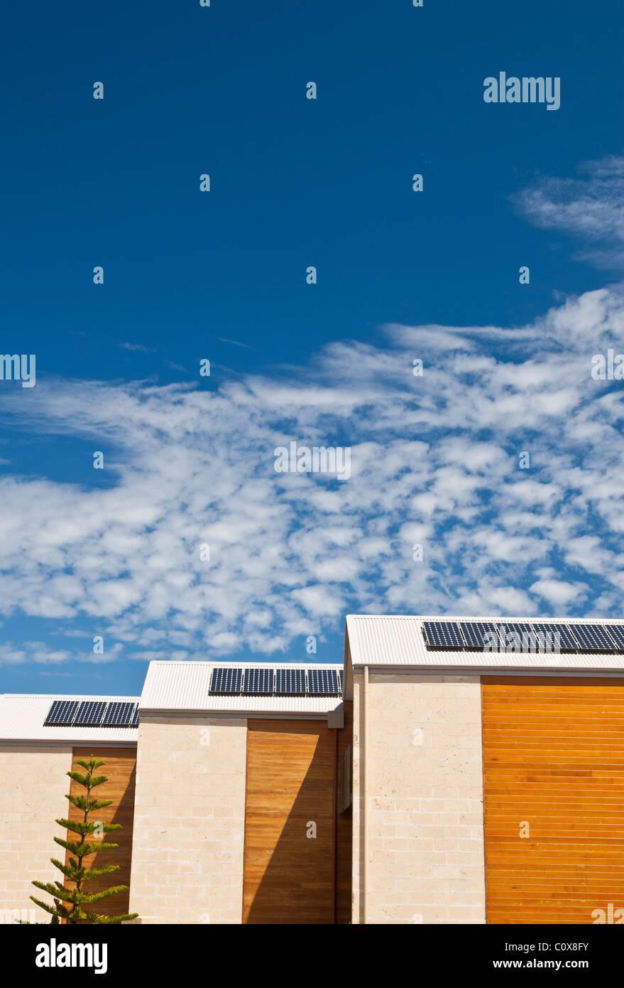 Solar panels on house roofs in Australia - Stock Image