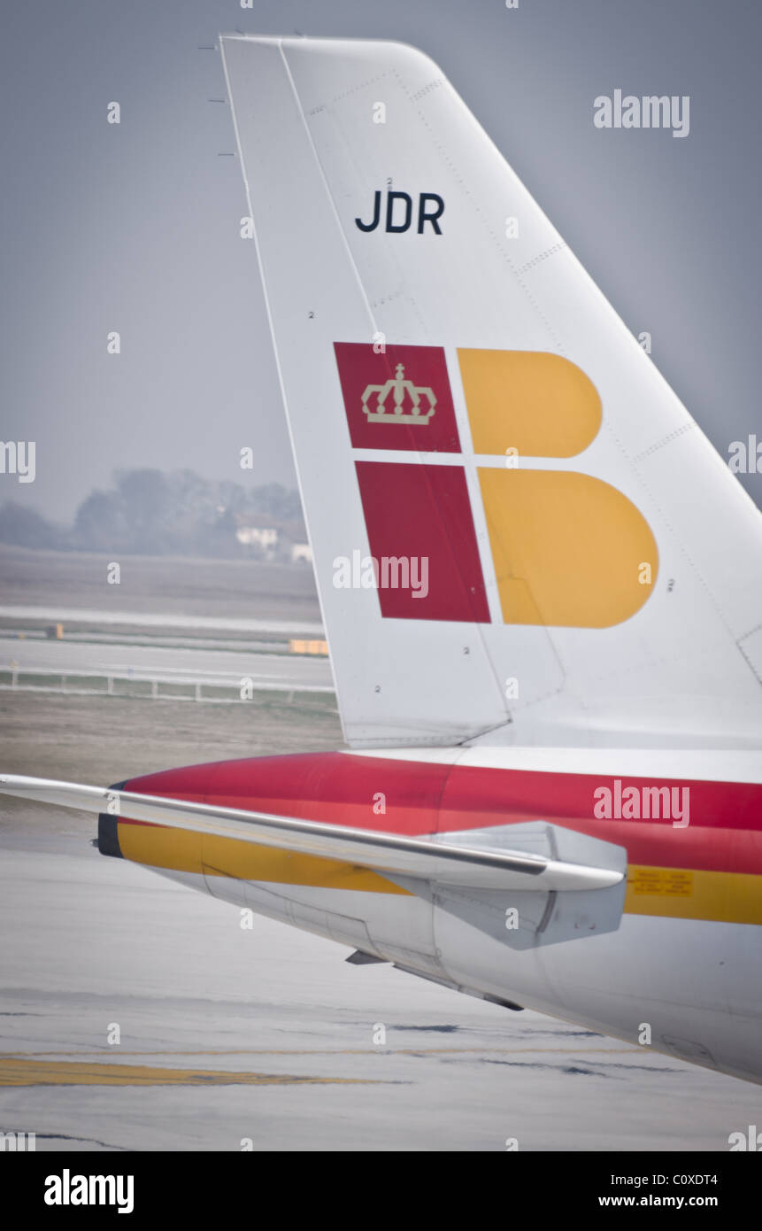 Iberia insignia on tail of jet plane - Stock Image