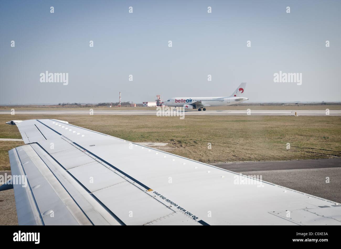 plane taxiing on runway - Stock Image