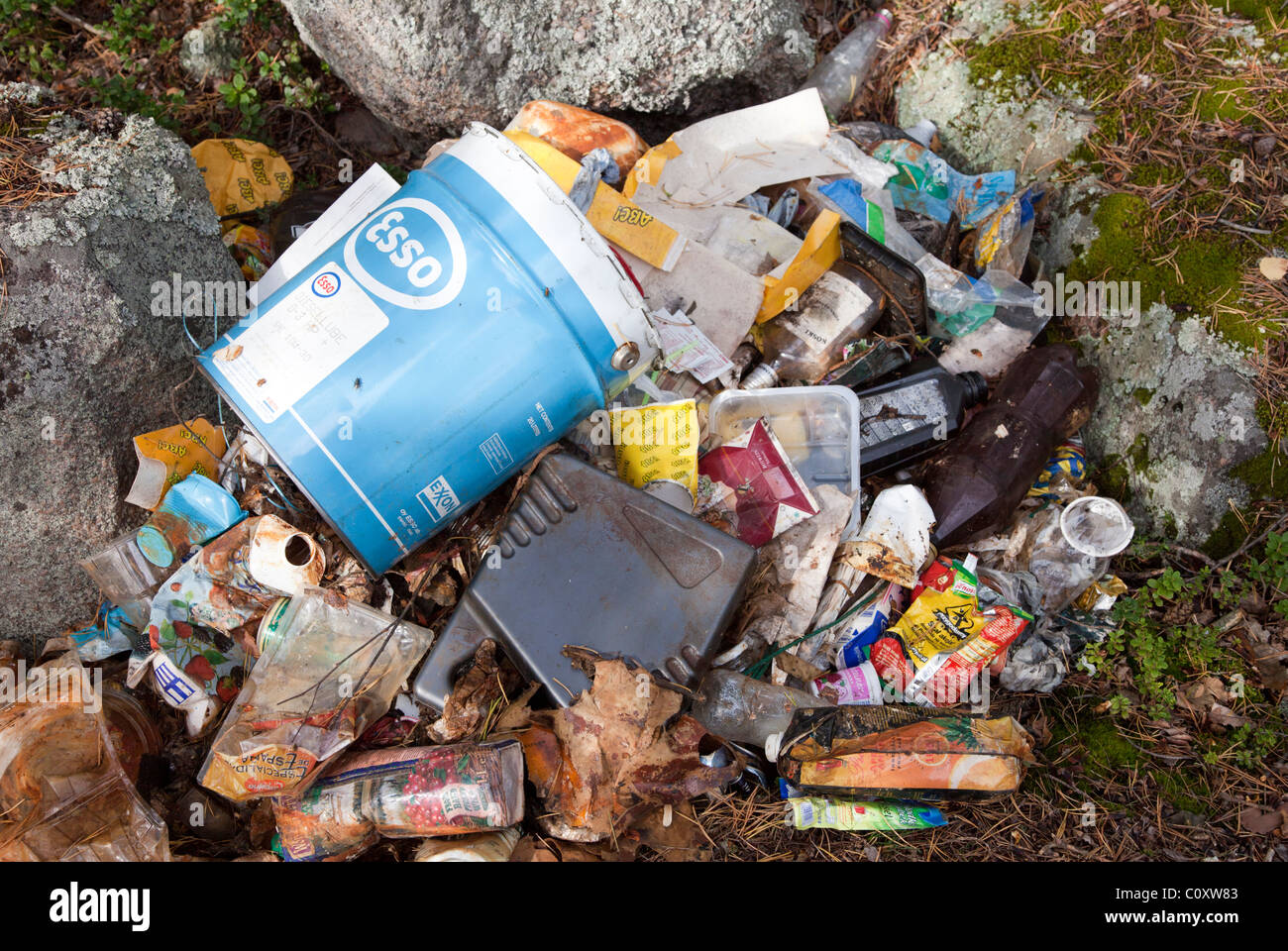 Garbage and trashes dumped to the nature - Stock Image