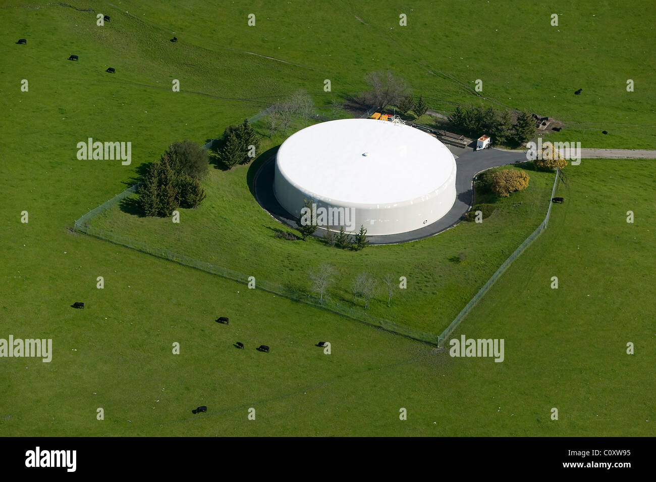 aerial view above large water holding tank pasture Sonoma County California - Stock Image