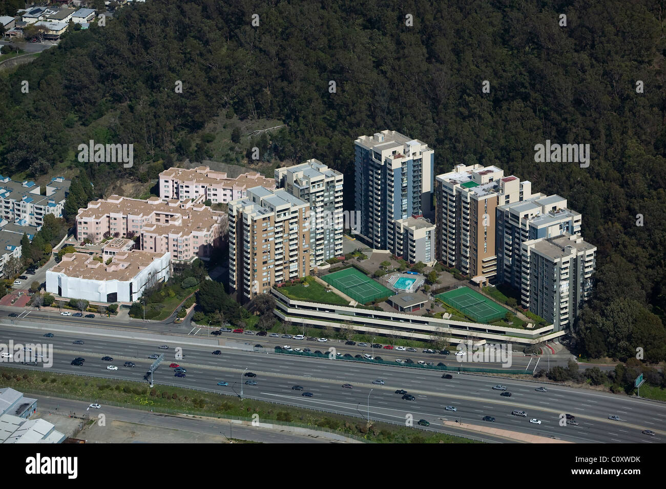 aerial view above high rise apartment buildings adjacent to interstate I-80 Albany Hill Park Albany California - Stock Image