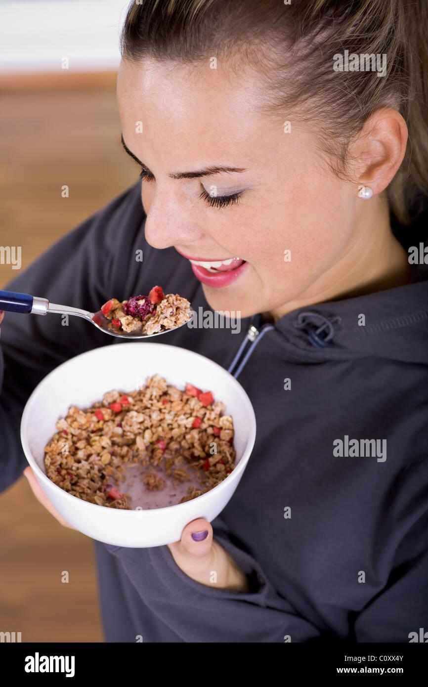 woman with muesli bowl Stock Photo