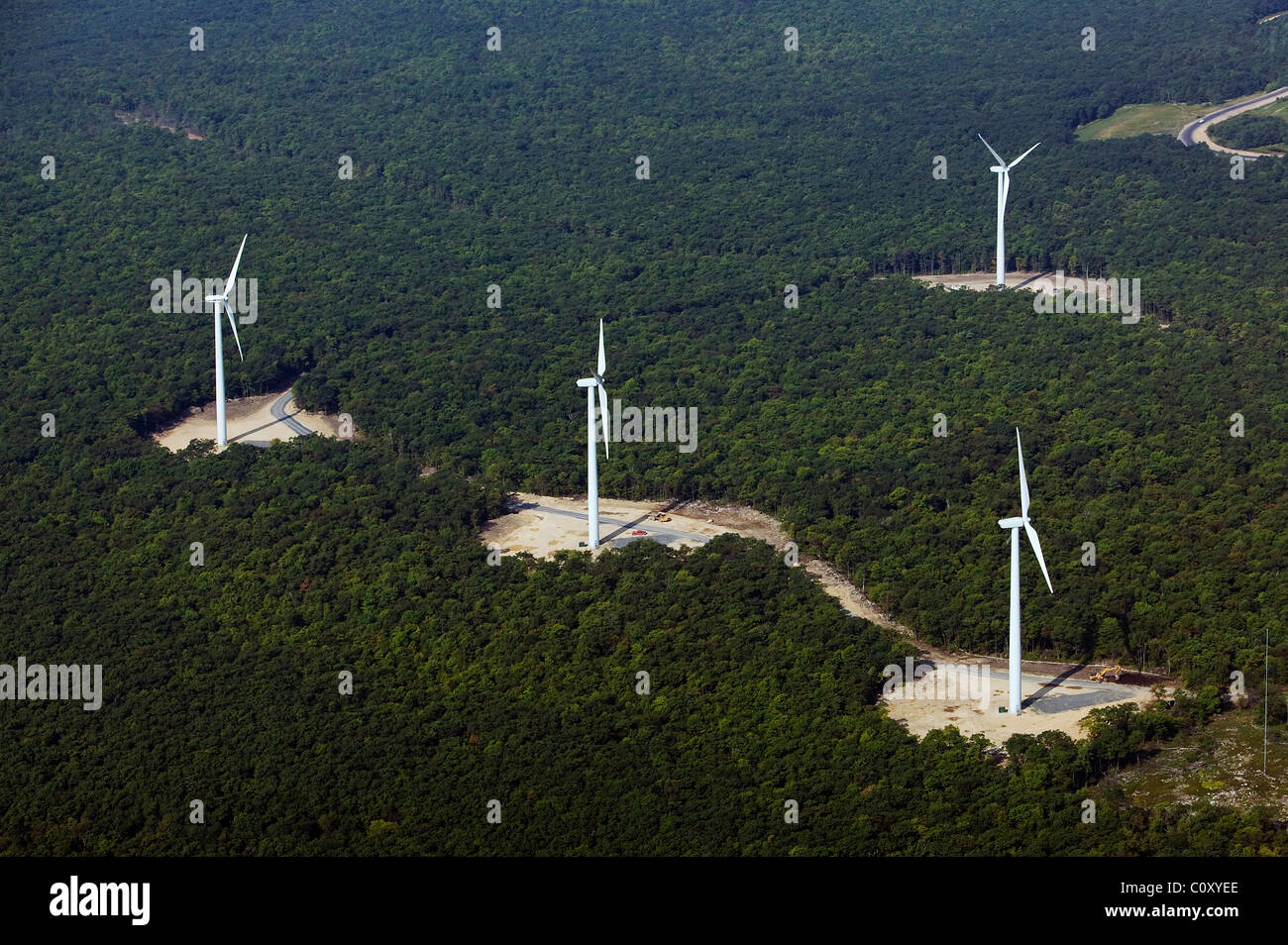 aerial view above wind turbines deciduous forest Appalachian mountains Pennsylvania - Stock Image