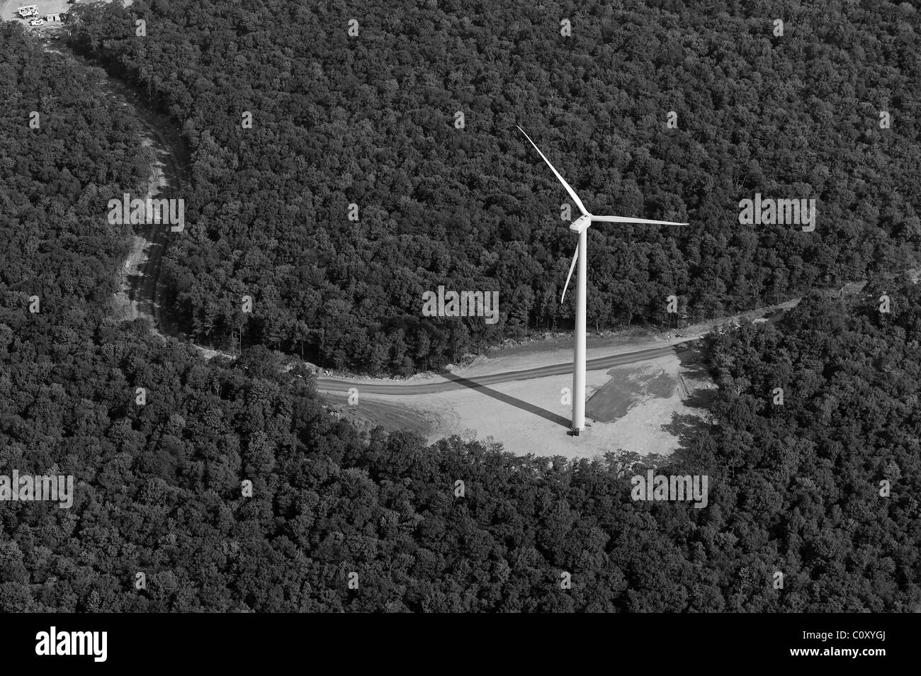aerial view above wind turbine deciduous forest Appalachian mountains Pennsylvania - Stock Image