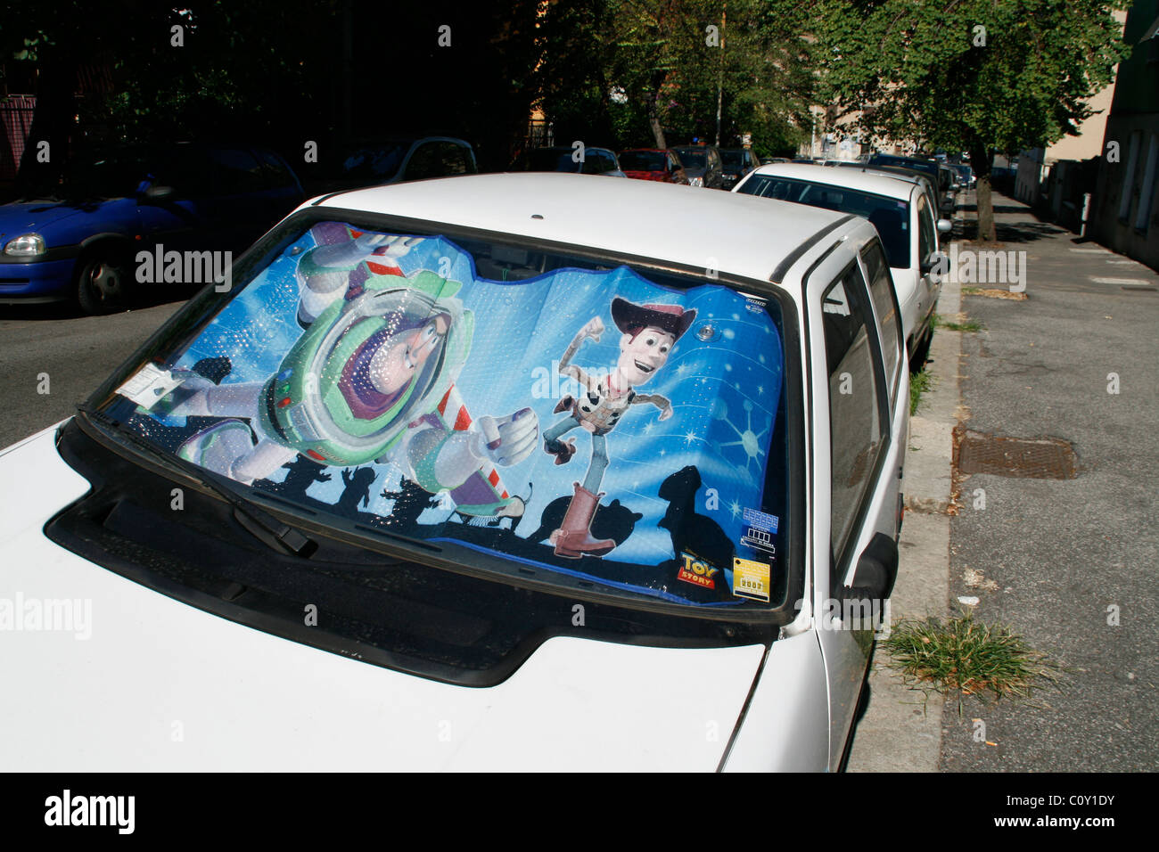 toy story film movie car windscreen sun reflector in rome - Stock Image