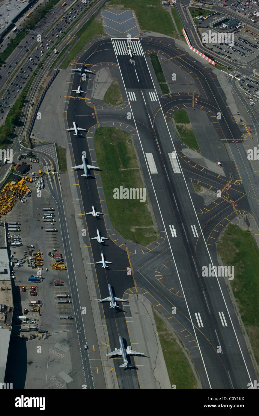 aerial view above departing aircraft runway 4 LaGuardia airport Queens New York - Stock Image