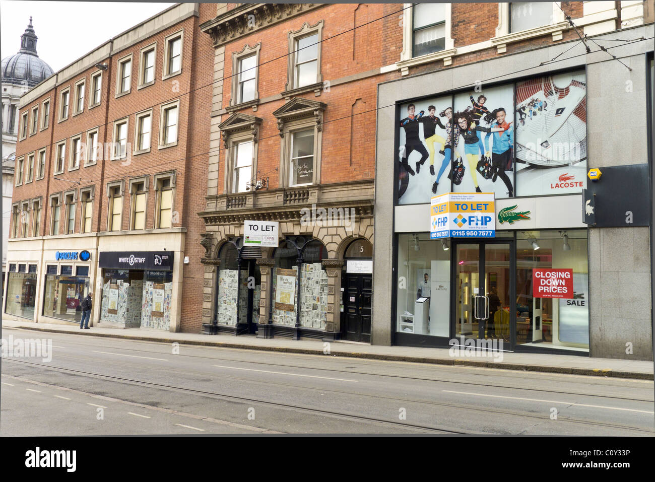Nottingham shops closed to let in March 2011 during the economic crisis. Lacoste  and White Stuff clothing. - Stock Image