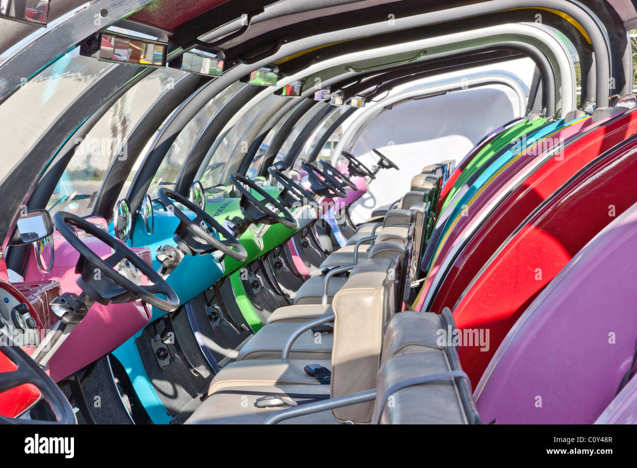Colorful electric buggies. - Stock Image